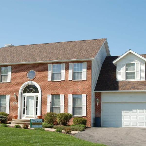 Brown Shingle Roof on Red Brick Home