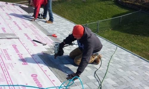 Installing New Grey Shingle Roof