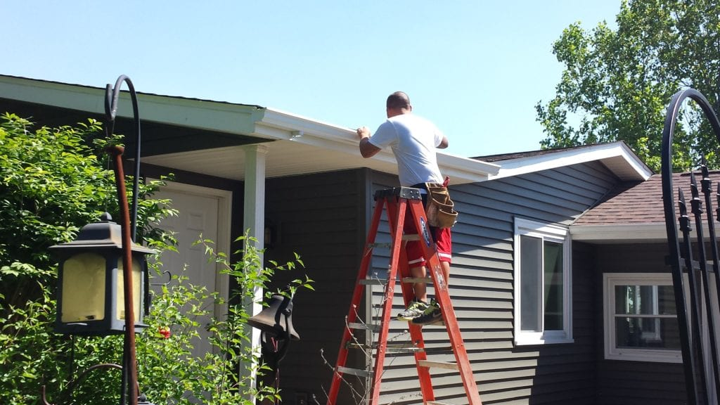 Finishing Install of New White Gutters