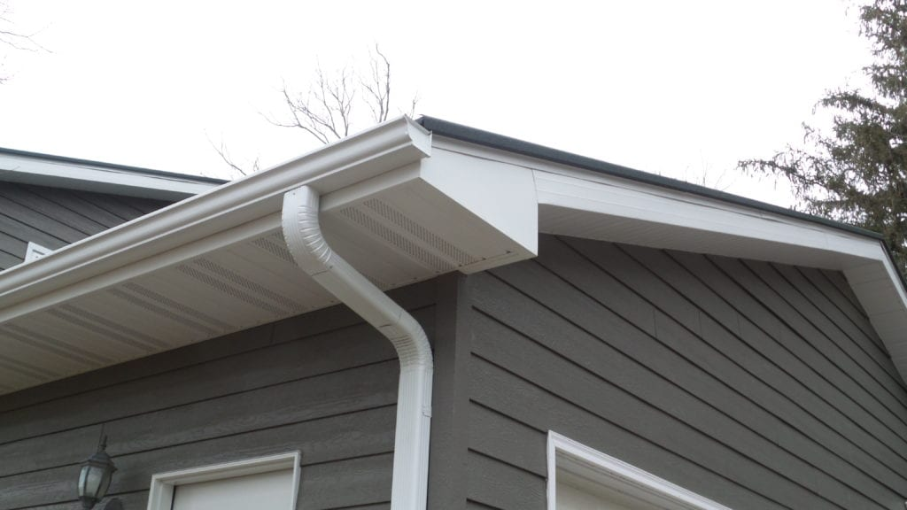 Closeup of White Downspout and Gutters
