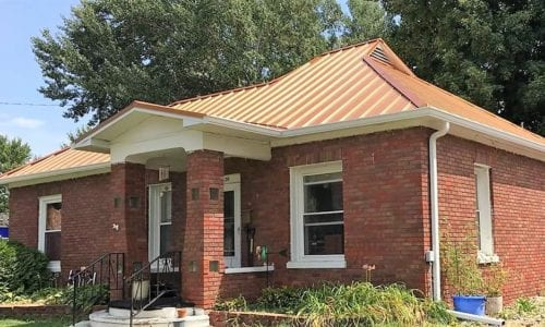 Gold Painted Steel Roof on Brick House