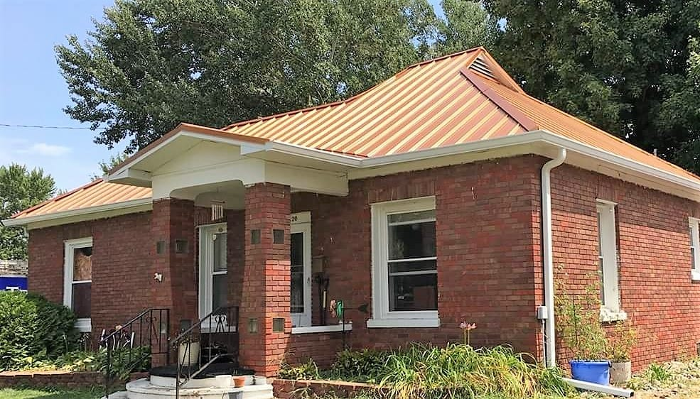 Gold Painted Steel Roof On Brick House Tri County