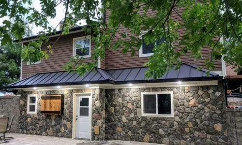 Brown Siding and Stone Work